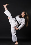 Girl in kimono exercising karate kata Royalty Free Stock Image