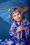 Girl in a kimono Royalty Free Stock Image