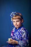 Girl in a kimono Stock Photos