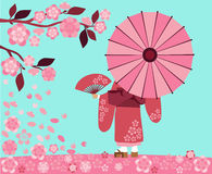 Girl in Kimono with sakura blossoms Stock Photo