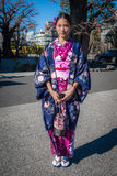 Girl in a Kimono. Tokyo, Japan - January 12, 2015: Woman dressed in a beautiful kimono at Senso-Ji Temple in Asakusa, Tokyo on 'Coming of Age Day&#x27 Royalty Free Stock Photography
