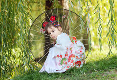 Girl in kimono under willow Stock Images