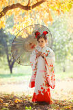 Girl in kimono walking in the city Park Royalty Free Stock Photography