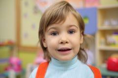 Girl in kindergarten Stock Images