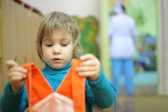 Girl in kindergarten with dress Royalty Free Stock Photo