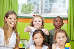 Girl in kindergarten group holding Stock Image