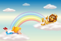 A girl and a king lion across the rainbow Royalty Free Stock Photos