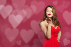Girl and a kiss with figurines heart Stock Photos