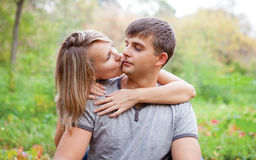 Girl kiss a guy on the cheek. Royalty Free Stock Images