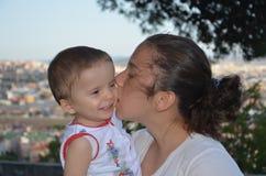 Girl kiss little boy. Gozdagi istanbul turkey kiss to little boy Royalty Free Stock Image