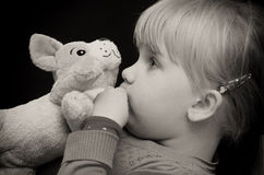Girl kiss toy bear Stock Photos