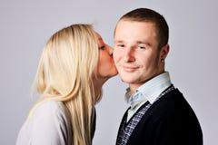 Girl kisses Royalty Free Stock Image