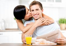 Girl kisses eating boyfriend Stock Photography