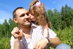 The girl kisses the father Stock Images