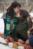A girl kisses a guy Stock Photo