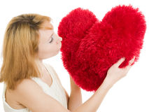 A girl kisses a heart Royalty Free Stock Photography