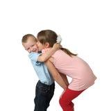 Girl kisses little boy on cheek Royalty Free Stock Photo