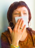 The girl kisses a paper. Wipes lips Royalty Free Stock Photo