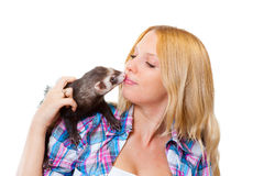 Girl Kissing A Ferret Royalty Free Stock Image