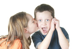Girl kissing boy Royalty Free Stock Images