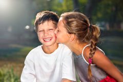 Girl kissing boy Royalty Free Stock Photos