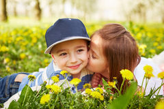 Girl kissing a boy Royalty Free Stock Images