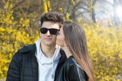 A girl kissing a boy in the cheek, Valentines day Royalty Free Stock Photography