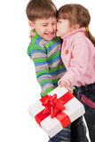 Girl kissing a boy with gift box Royalty Free Stock Photos