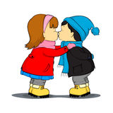 Girl kissing boy Stock Images