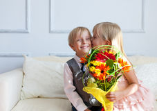 A girl is kissing a boy. Royalty Free Stock Photography