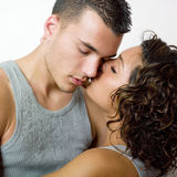 Girl kissing boyfriend Royalty Free Stock Images