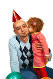 Girl kissing father at party Stock Images