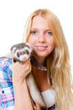 Girl kissing a ferret Royalty Free Stock Images