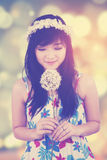Girl kissing flower with bokeh background Royalty Free Stock Images