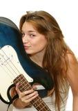 Girl kissing a guitar stock photo