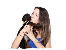 Girl kissing her doberman puppy Royalty Free Stock Images