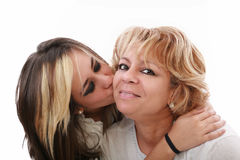 Girl kissing her mom Stock Image