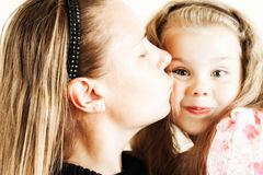 Girl kissing her mother Stock Photography