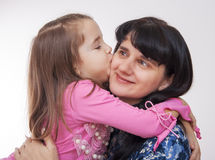 Girl kissing her mother Royalty Free Stock Image