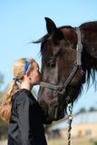 Girl Kissing Her Pony Stock Image