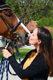 Girl kissing horse Stock Photos