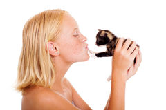 Girl kissing kitten Stock Photo