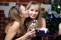 Girl kissing and make a present Royalty Free Stock Photography