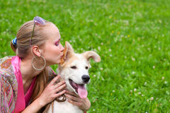 Girl kissing puppy Royalty Free Stock Images