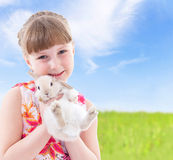 Girl kissing a rabbit Royalty Free Stock Photography