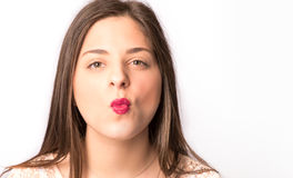 Girl Kissing with red lipstick. And white backgroundnn stock images