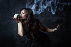 Girl kissing skull. Girl kissing small white skull royalty free stock images