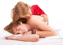 Girl kissing sleeping boyfriend Royalty Free Stock Photos