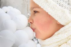 Girl kissing snowballs Stock Photos