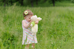 Girl Kissing Teddy Bear Stock Photography